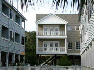 Large covered porches to enjoy the beachlife.  Looks toward the beach
