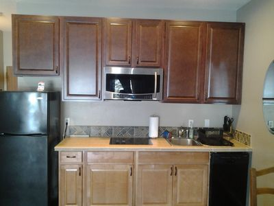 Convection/microwave combo oven and cook topburners.Fridge and dishwasher.