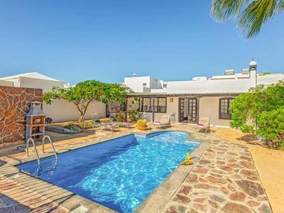Photo for Casa Alfred is a traditional style villa in the heart of busy Puerto del Carmen.