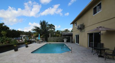 Photo for Pool house on the water near beach, downtown, & 95