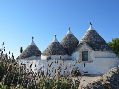 Photo for Charming and romantic XIX century stone trulli with pool