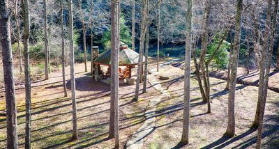 Covered Gazebo and wood fireplace walkway from the cabin