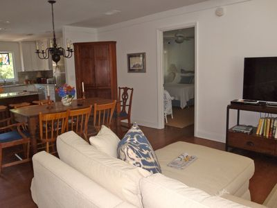 Family room with 48' Smart HD TV and view to bedroom, dining area & kitchen