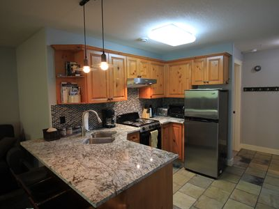 Photo for True Ski in/out  I bedroom 2 bath Private hot tub sleeps 5  Village location