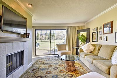 Curl up on the comfy couch in front of the wood-burning fireplace in the living area.