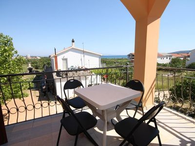 Photo for Two bedroom apartment with terrace and sea view Tribunj, Vodice (A-6223-a)
