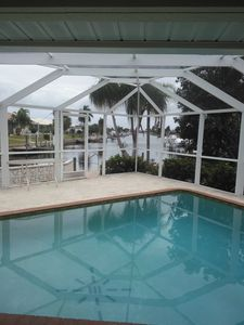 Photo for BEAUTIFUL 3/2.5 DOG FRIENDLY Screened Pool Home on Canal