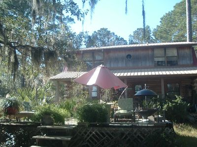Camp Nina is a two story log home with a great view from the deck and porch.