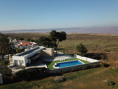 Photo for Villa with pool, Wifi, in front of Laguna Salada, unforgettable sunsets.