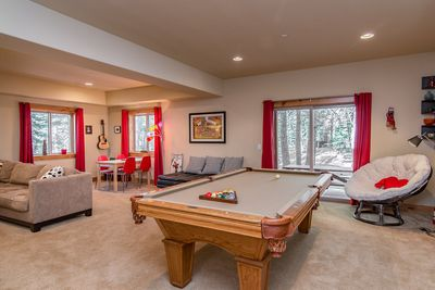 Game Room - The cozy game room has plenty of seating and access to the backyard