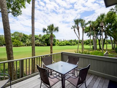 Spacious deck with steps to golf course