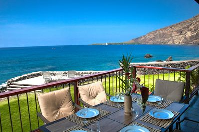 Breathtaking View from Lanai of Kealakekua Bay featuring covered outdoor dining.