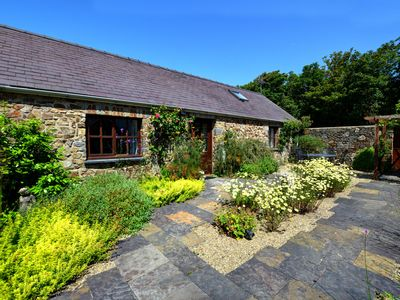 Photo for Rose cottage is one of a group of cottages created by converting traditional stone barns. Sleeping u