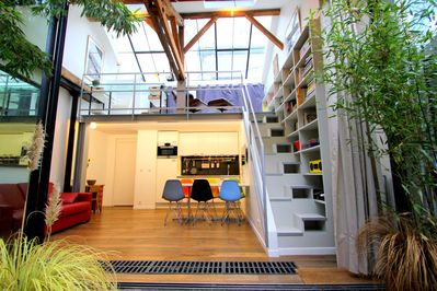 Our incredibly charming duplex loft is ideally located in the Marais