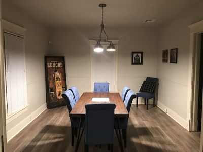 Dining room decorated with Edmond photos and 1915 charm.