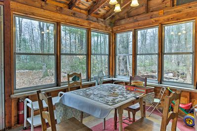 Have fun doing puzzles in the enclosed porch with your party of 5.