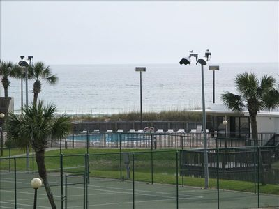 VIEW FROM BALCONY!! TENNIS COURTS, POOL, SHUFFLE BOARD, GAME ROOM!!
