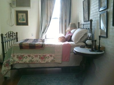 sleeping alcove with antique brass bed