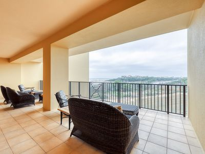Photo for Gulf-front condo w/ balcony, multiple pools, hot tubs, gym & beach access!
