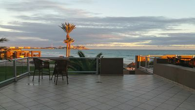 Photo for LAS PALOMAS GROUND FLOOR 2BR OCEANFRONT CONDO. HUGE PATIO STEPS FROM BEACH!