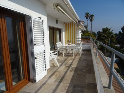 Photo for SPECIAL OFFER ... LOVELY TOP FLOOR WITH SPECTACULAR SEA AND POOL VIEW, FREE WIFI