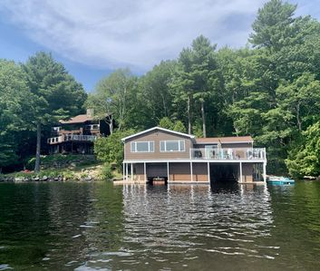 View of the cottage and boathouse from the water
