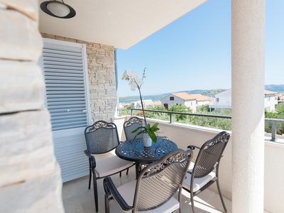 Photo for Two bedroom apartment with terrace and sea view Murter (A-16655-b)