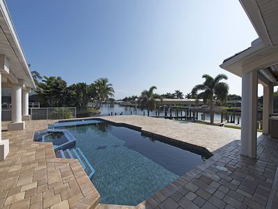 Photo for Stunning waterfront home with new renovated pool in prime location!