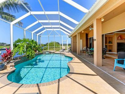 Photo for SWFL Rentals - Villa Ellis - Tommy Bahama Style Pool Home w/Gulf Access in NW Cape Coral