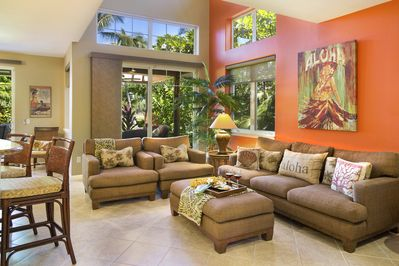 Beautifully appointed living room w/ high end furnishings and original artwork