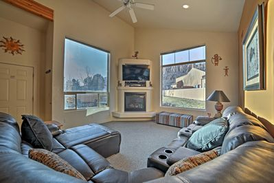 The living room boasts comfy furniture and a flat-screen cable TV.