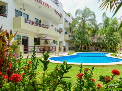 Photo for Deluxe Spacious Poolside Condo walk to 5th Ave,Beach, Supermarkets, Restaurants