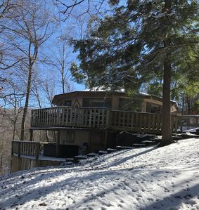 A winter side view of our 2-story, 4 season  home - with hot tub on lower deck.