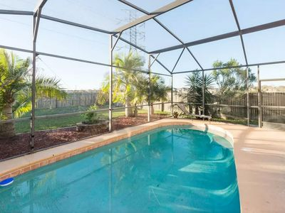 Photo for Remodeled 2019 4 Bedroom Vacation Home With Private Pool! 15 Minutes to Disney!
