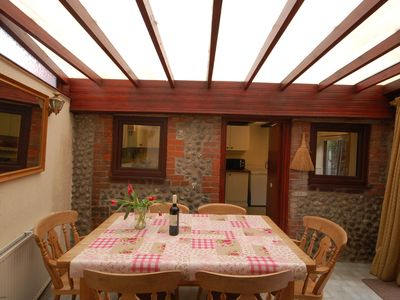 Photo for This charming semi detached holiday cottage is a few minutes' walk to the sea and shops