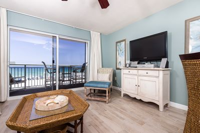 Open floor plan  - Additional view of the beach front living room with beautiful new flooring.