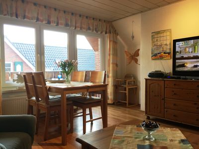 Photo for Cozy apartment for up to 4 people in Neßmersiel on the North Sea coast
