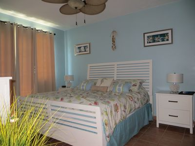 King-size in master bedroom with views of water right out window. En-suite bath.