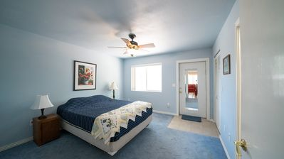 Master bedroom offers privacy as well as access to the back yard. Walk-in closet is an added bonus.