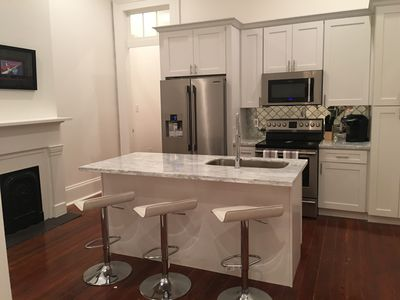 Photo for 3bed,2 huge marble baths and kit! Gated property w/parking. Just off St Charles!