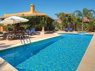Photo for Vibrant villa w/ golf course views, large pool and second lounge w/ entertainment