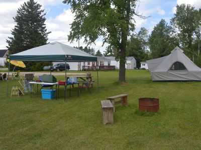 Relax in an outfitter tent overlooking the Manistique River. Sleeps 4 on cots.