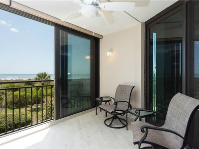You may never leave our screened balcony - Our screened balcony is so spacious and beautiful, you may never leave it. Enjoy al fresco meals, lounge and read, lay back and nap, or just enjoy the ocean views and views of Crescent Beach. Anastasia 310 is a luxury condo in St. Augustine Beach, Florida.