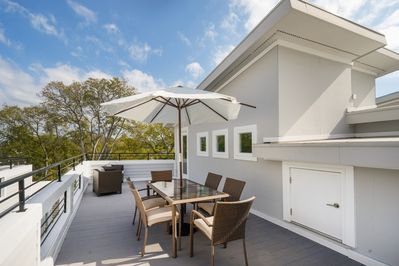 Exterior - A private rooftop deck takes outdoor living to another level-- complete with expansive tree-top views.