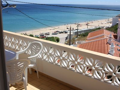 Photo for Apartment by the sea, terrace with sea view and garden terrace in Salema