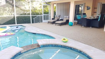 inviting Patio with heated pool and user friendly Jacuzzi