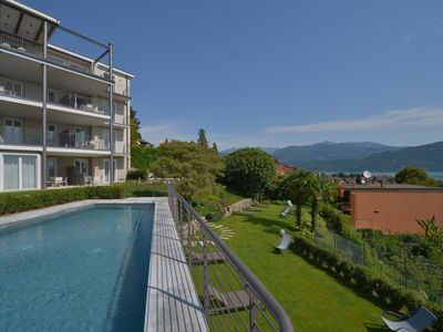 Photo for The View - Wind: design apartment with terrace, lake view and pool