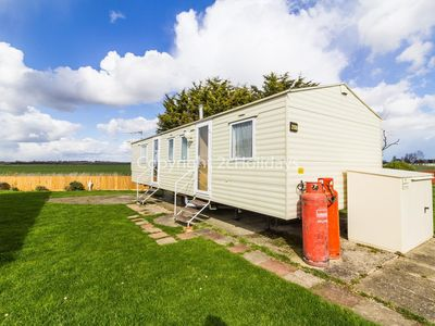 Photo for 8 berth caravan with field views for hire in Seawick holiday park ref 27258