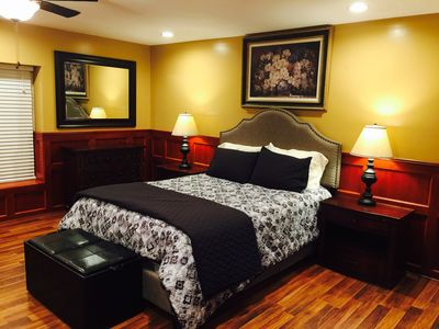 Large Queen sized bed in our oversized bedroom.