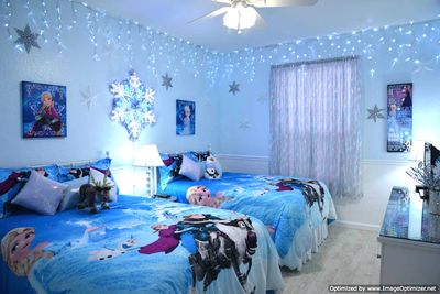 Sparkling Frozen Room features dual full beds with iridescent glittered walls.